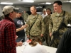 """Sgt. Isaiah Myers, a soldier assigned to Troop B, 1st Squadron, 33rd Cavalry Regiment, 3rd Brigade Combat Team \""""Rakkasans,\"""" 101st Airborne Division (Air Assault), speaks with songwriter Thomas Verges during an autograph session by the Nashville to You Tour at Camp Clark, Nov. 15, 2012. Myers and Verges discussed how they born and raised not far from each other in Louisiana. The tour featured Nashville\'s top songwriters and performers as they traveled throughout Afghanistan performing for deployed soldiers. (U.S. Army Photo by Sgt. 1st Class Abram Pinnington, TF 3/101 PAO)"""
