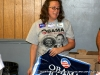 Kim Smith helps with yard signs