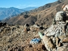 U.S. Army Sgt. Joseph P. Khamvongsa, an infantryman from Mililani, Hawaii, assigned to Bayonet Company, 2nd Battalion, 327th Infantry Regiment, Task Force No Slack, uses binoculars to check out the mountainside overlooking the Ganjgal Valley in eastern Afghanistan's Kunar Province Dec. 11th. (Photo by U.S. Army Staff Sgt. Mark Burrell, Task Force Bastogne Public Affairs)