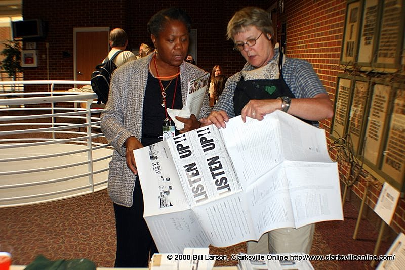 Prof. Cynthia Marsh shows Beulah Oldham, Director, African American Culture Ctr, conference exhibit prints
