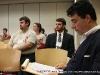 Dr. Greg Ribidoux (r) and Garrett Spivey, Lee Univ., Phi Alpha Theta, (c) listen to President Hall