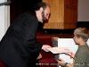 A young fan gets an autograph from Peter Jordan