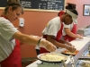 Amanda and Clarissa make pizza\'s for the guests