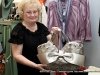 Author Sue Culverhouse holding up one of the fine handbags offered at Rogate\'s Boutique