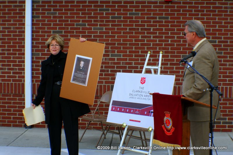 James D. Amos listens as the shelter is named after him