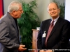 City Councilman Geno Grubbs in conversation with former Councilman Richard Swift
