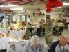Soldiers deployed to Afghanistan enjoy a large Christmas lunch on Christmas Day. The dining facility maximized every effort to ensure the Soldiers experienced the best dining expeience possible while deployed away from their familes during the holiday season. (U.S. Army photo by Sgt. 1st Class Abram Pinnington, TF 3/101 Public Affairs)