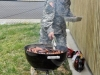 """Sgt 1st Class Fernando Silva, the first sergeant of Headquarters and Headquarters Company, 526th Brigade Support Battalion, 2nd Brigade Combat Team, 101st Airborne Division (Air Assault), turns the hotdogs as he volunteers his grill and his cooking skills in support of the special needs student athletes from the Fort Campbell schools during the Area 12 Special Olympics held at Clarksville's Austin Peay Stadium on April 18. """"It's just about helping the kids and giving something back to the community and leading by example,"""" said Silva.(US Army photo by Sgt. Keith Rogers, 2nd BCT UPAR, 101st Abn. Div.)"""