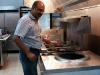 Tandoor owner Hakeem inspects his new tandoor oven