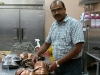Tandoor owner Hakeem sorting his distinctive copper dishes