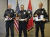 Officers Wilson, Danault, and Lee with their medals. (Photo by CPD-Jim Knoll)