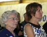 Tim\'s mother and wife listen as he addresses his supporters