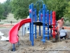 Workers installing new playground equipment at Valleybrook Park.