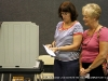 A poll worker assisting a voter at Hilldale United Methodist Church (District 19)