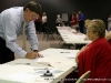 A voter signs in at Hilldale United Methodist Church (District 19)