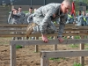 Sgt. Bill Eldridge, part of the winning team in the Wedge Challenge negotiates the six vaults obstacle April 25, 2014 at Fort Campbell, Ky. The Wedge Challenge was a battalion event, where teams of unit leaders demonstrated air assault skills to junior Soldiers during a friendly competition. (U.S. Army photo by Sgt. 1st Class Mary Rose Mittlesteadt, 101st Sustainment Brigade Public Affairs)
