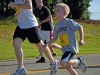 A young child sprints along Air Assault Rd. in support of honoring those who have made the ultimate sacrifice during a Run for the Fallen during Fort Campbell's Week of the Eagles 2012, Aug. 11th.  The run was open to families, Soldiers, Veterans and anyone who wanted to pay their respects. (U.S. Army photo by Spc. Sara Connolly, 2nd BCT PAO, 101st ABN.DIV)