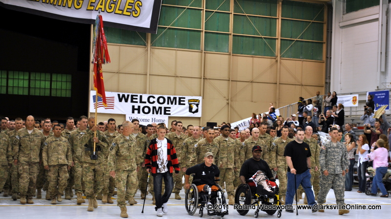 Wounded soldiers rejoin their brothers at the front of the formation at the welcome home ceremony