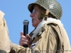 A WWII Veteran of the 101st Airborne Divison narrates during a WWII historical demonstration