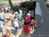 A line of people wait their turn to peek inside a UH60 Blackhawk.
