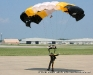 A member of The 101st Airborne Division (Air Assault) Command Parachute Demonstration Team touching down