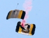Two parachutes linked in a dive towards the ground