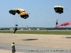 The 101st Airborne Division (Air Assault) Command Parachute Demonstration Team moments from landing.