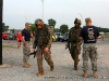 Soldier teams finish the 12 mile Ruck march at the Toughest Air Assault Soldier Competition