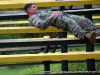 2nd Lt. Rob Eberts shows iron determination as he navigates the weaver obstacle at the Toughest Air Assault Soldier Competition