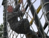 1st Lt. Joey Keller climbs down the cargo net as part of the as part of the tough one obstacle at the Toughest Air Assault Soldier Competition