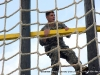 2nd LT. Eberts climbs up the ladder as part of the tough one obstacle at the Toughest Air Assault Soldier Competition