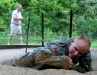 1st Lt. Keller clears the barb wire on the belly crawl as his partner 2nd Lt. Eberts suffers from another cramp at the Toughest Air Assault Soldier Competition