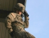 Coming down from the Repel tower at the Toughest Air Assault Soldier Competition