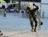 A soldier repels as the spectators look on at the Toughest Air Assault Soldier Competition