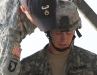 The safety officer inspects Spc. Chris Richards gear before allowing him to proceed down the tower at the Toughest Air Assault Soldier Competition