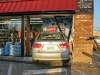 Brakes on the Hyundai Elantra fail and it crashed through the glass of the Shell Sudden Service on Wilma Rudolph Boulevard. (Photo by CPD-Jim Knoll)