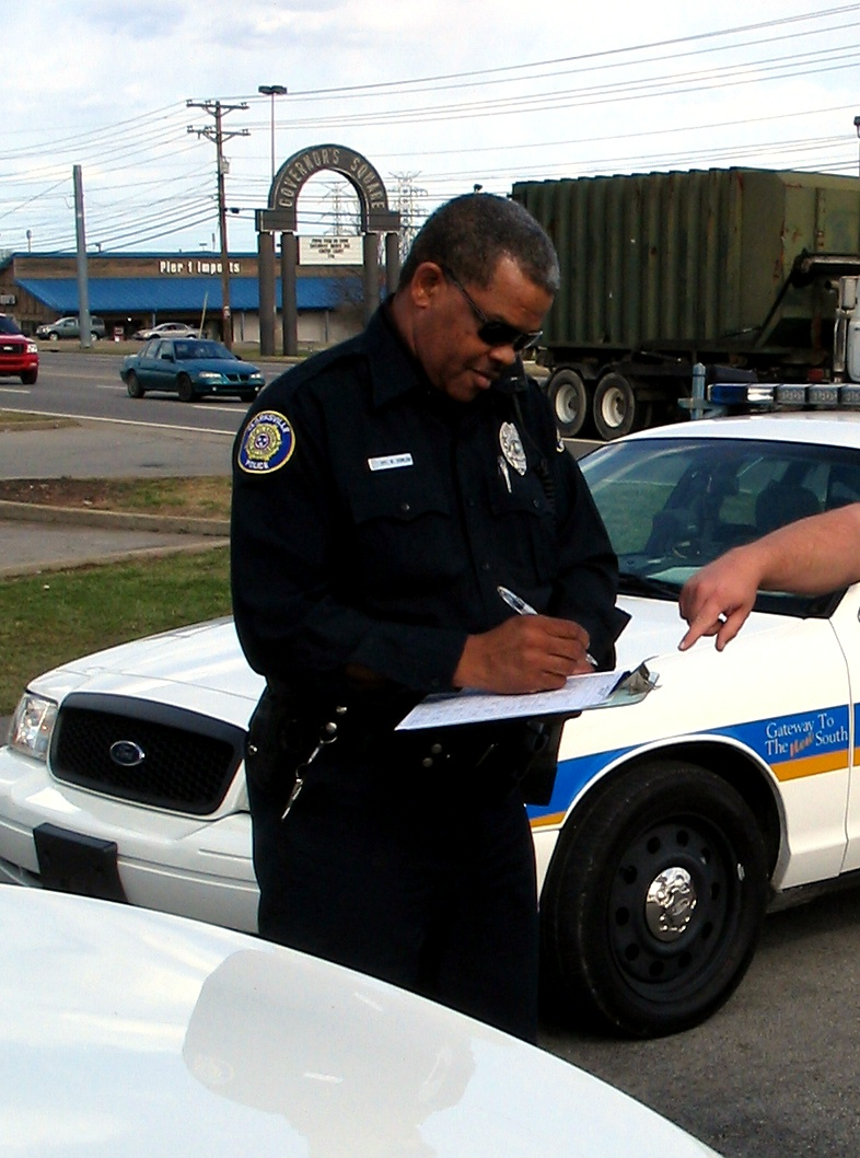 A Clarksville, TN Police officer takes a accident report