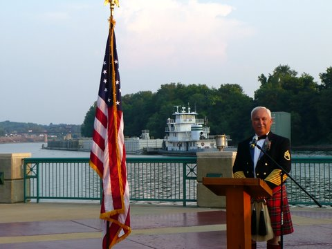 The Master of Ceremonies and the American flag frame an image familiar to most Clarksville Residents