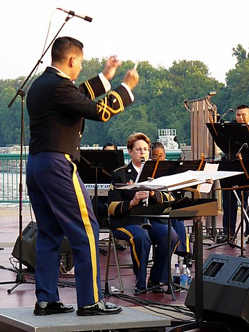 Commender of the 91st Division band CW2 Richard Servantez launches into the first number