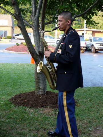 Specialist Jheirl Rivera warming up on his Tenor Saxophone