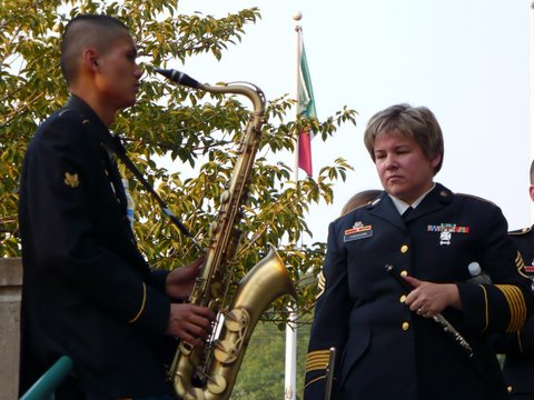 Flute & Picclo section leader SSG Gena Hassan is deep in thought as fellow band members warm up around her