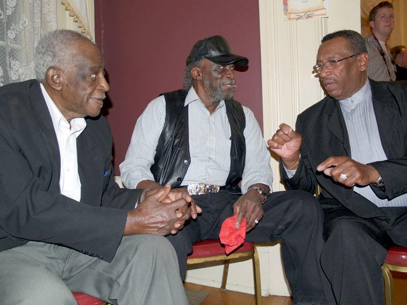 co-dems-three-men-talking.jpg