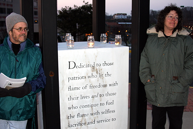 David and Debbie Boen listening to others speaking at the vigil
