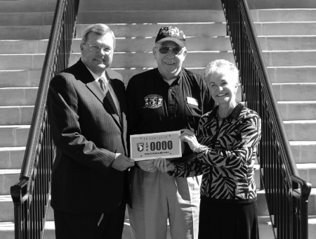 From left, Rep. Curtis Johnson, Association Secretary/Treasurer Sam Bass, and Representative Rosalind Kurita stand outside the Clarksville Courthouse with the new 101st license plate. Photo by 101st Association Graphic Designer Katie Rodriguez.