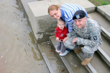 Tim and Ana show their 15 month old son Johnny the rising river at the McGregor park terrace.