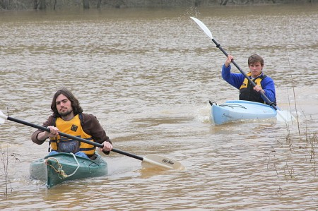 With the Red River having overflowed it\'s banks it was the perfect opportunity for a little backyard kayaking. Randall Boen (front) and Ted Kitterman (behind) make it look easy. At the same time they are practicing safe watersports by wearing their floation devices.