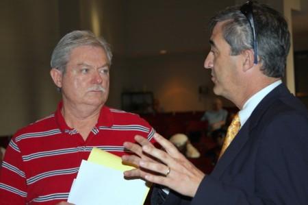 Don Sharp (L) speaks to Co-Interim City Attorney Tim Harvey (R)