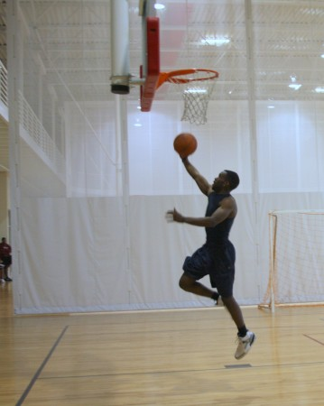 An APSU student does a layup shot in the campus fitness center