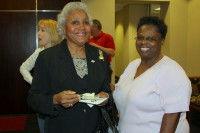 City council member/Mayor Pro temp Barbara Johnson chats with reception atendee
