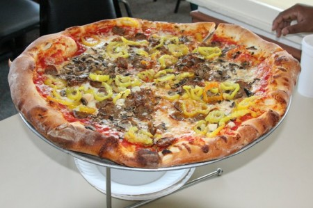 Italian sausage, mushrooms, garlic, banan peppers and 18 inches all around! Mm-m-m-m!